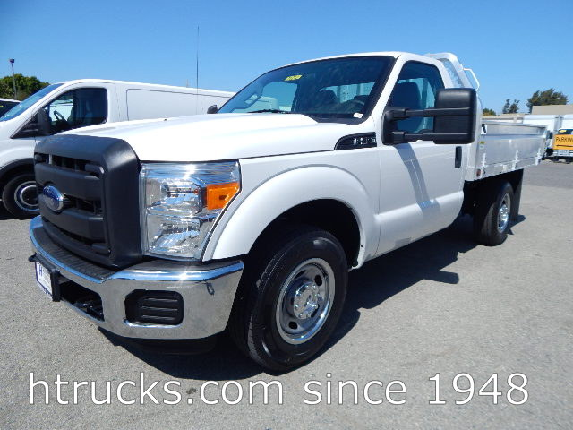 2015 Ford F250 8.5' ALUMINUM FLATBED with Fold Down Sides